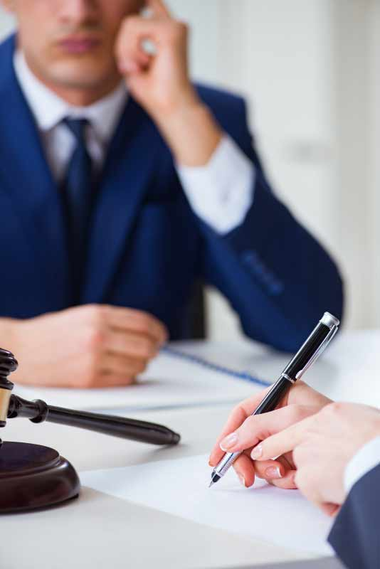 attorney signing document with client